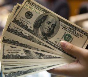Dólar cai ante real com exterior e otimismo com Previdência